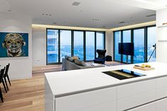 Immaculately White Luxury Apartment Adorned With Art Exhibits in Tel Aviv - http://freshome.com/2012/11/14/sky-scraper-tel-aviv-white-luxury-apartment/