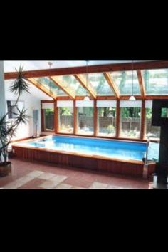 Indoor Endless Pool & Spa with glass framing this is the look I'm going for