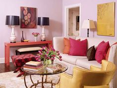 awesome!  The energetic colors of this South Carolina living room by designer Angie Hranowski set the tone for the whole house. Walls are painted Persian Pink by Porter. A Crate & Barrel sofa with a custom linen slipcover is paired with a vintage chair in yellow silk. The red stool's fabric is Herbert's Carnation Weave, David Hicks by Ashley Hicks for Lee Jofa.