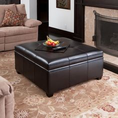 This ottoman can be used for storage and as a coffee table when
