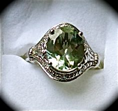 Karis Collection Montezuma Prasiolite (oval 4.0ct.) Simulated Diamond Ring Plat Bond Brass TGW 4.10 cts. Size 8     $65.00