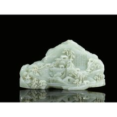 A MAGNIFICENT AND EXTREMELY LARGE WHITE JADE MOUNTAIN QING DYNASTY, QIANLONG PERIOD