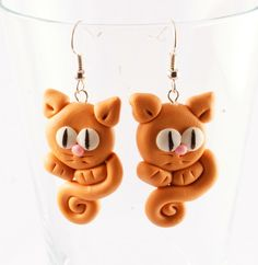 RED CATS polymer clay earrings. $5.00, via Etsy.