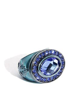 Costume jewelry ring in turquoise with large crystals at the centre and ornamentally decorated sides $30