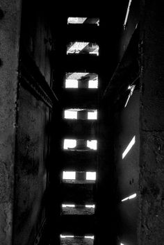 """Industrial Abstract Photography """"Indifference"""" - obscure light through a railroad bridge."""