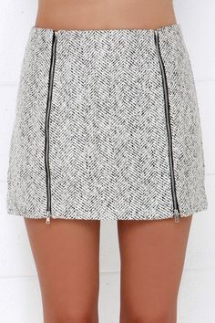 Grey tweed skirt features two exposed vertical zippers at front.. DIY the look yourself: http://mjtrends.com/pins.php?name=zippers-for-tweed-skirt
