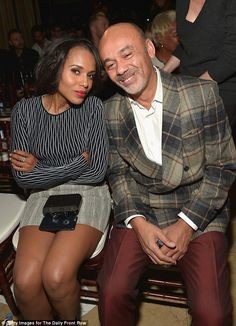 In good company: Kerry was spotted sitting alongside fashion designer Christian Louboutin
