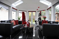 The black and red combination is a great choice to create a striking look in this sleek and stylish conservatory. Comfortable, cosy and welcoming Upvc Windows, Conservatory, Interior Inspiration, Cosy, Doors, Table Decorations, Furniture, Create, Stylish
