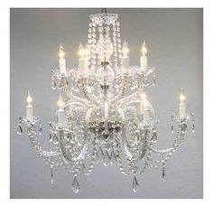 Dining or foyer - This beautiful chandelier is decorated with crystal that capture and reflect the light of the candle bulbs, each resting in a scalloped bobache. This crystal chandelier is sure to lend a special atmosphere in any home. Crystal Chandelier Lighting, Candle Style Chandelier, Crystal Candles, Lighting, Lights, Chandeliers And Pendants, Candle Styling, Chandelier, Ceiling Lights