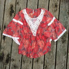 Free People watercolor lace top size small Flowy, polyester top with lace embellishment. Free spirited and elegant, vibrant but not showy. Free People Tops Blouses