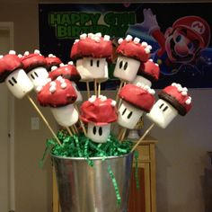 We made these marshmallow and chocolate covered brownie pops for my nephew's Super Mario themed party!! Super easy and fun! The eyes are made from edible marker.