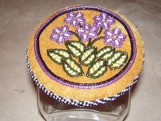 Beaded jar, African violets on moose hide. Alaska native beadwork by Liisia Carlo Edwardsen.