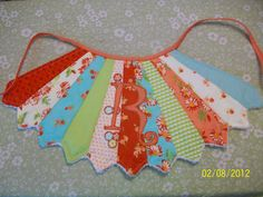 Baby Bib....how CUTE is that!!! (esp for a little girl!) - would even make a fab apron or skirt