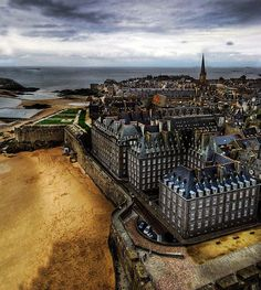 Saint-Malo, France - I loved it here! Very touristy but still fun (even if it did rain just about the entire time). :)     This picture isn't mine but props to the person who took it.