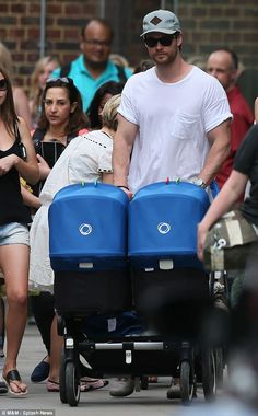 Double trouble: If his looming figure wasn't enough, Chris Hemsworth pushed a Bugaboo Donkey down the road #BugabooLovers #bugaboo