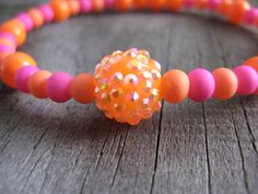Neon Orange Tangerine Faceted Charm Bead Beaded Stretch Bracelet with Blue and Gold Glass Bead Accents on Etsy, $7.50   https://www.etsy.com/listing/188999668/neon-orange-tangerine-faceted-charm-bead