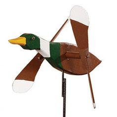 Mallard Duck Whirly Bird / Whirligig Wind Spinner | Dress The Yard The Mallard Duck Whirly Bird is the perfect finishing touch for your yard. This durable unique whirly bird is hand crafted by skilled Amish craftsmen from exterior grade wood and then hand painted and is made to stake into the ground and its wings spin freely in the wind.