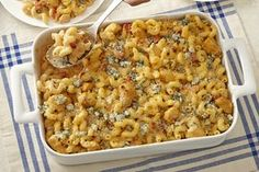 Melt-in-your-mouth buffalo chicken macaroni and cheese brings more flavor to an old family favorite.