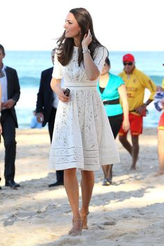 During her and Prince William's tour of Australia, Kate Middleton  wore a white eyelet dress by Australian designer Zimmermann with another pair of Stuart Weitzman wedges to an event at Manly Beach in Sydney.