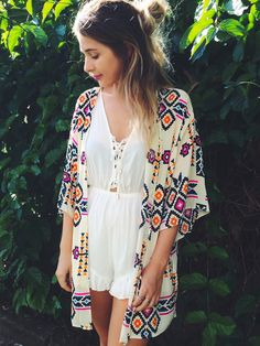 A white romper and colorful kimono make the perfect summer festival outfit