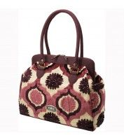 I want to have a baby just so I can get this fancy, expensive diaper bag.   Plum Tart Cake - Cosmopolitan Carryall