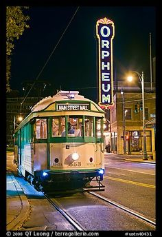 The Main St. Trolley runs by the Orpheum Theatre at night in Memphis, TN
