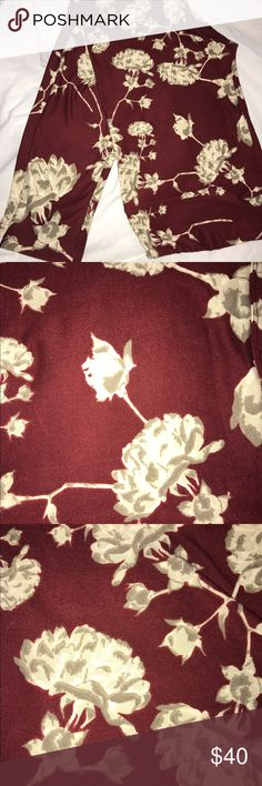 TC Floral Leggings Beautiful buttery soft LulaRoe tall & curvy floral leggings. Wine color. Made in China. BNWT. Reasonable offers considered. No trades. Bundle and save. LuLaRoe Pants Leggings