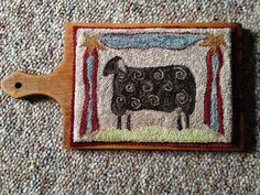 Sheep punch needle cutting board by WOOLnWOODnVINTAGE on Etsy https://www.etsy.com/listing/235689596/sheep-punch-needle-cutting-board
