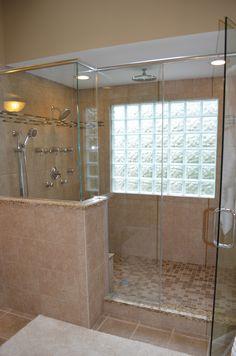 Walk in shower with glass block windows.
