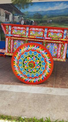 Hand Painted Ox Cart from Sarchi- Costa Rica. We watched a deaf man hand paint something similar to this. It was amazing!!