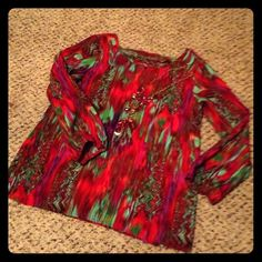 Beautiful multi colored top with open back Beautiful multi colored top with open back at top. Very pretty with skinny jeans and heels! Size M. Smoke free home Francesca's Collections Tops Blouses
