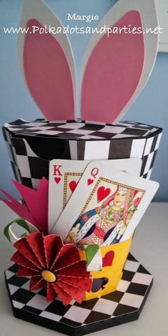 Easter Bonnets Inspiration Hat Box. This great inspirational hat box comes from Alice in Wonderland series. The playing card element adds a magic flavor to this cool hat box and the bunny ears at the top makes it funnier. http://hative.com/cool-easter-bonnet-or-hat-ideas/