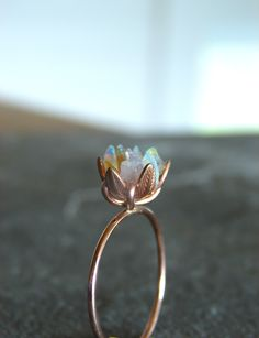 Unique Opal Ring, Custom Uncut Opal Engagement Ring, Lotus Flower Ring in Rose Gold, Raw Rough Fire Opal Jewelry for Women, Birthstone Rings by Gemologies on Etsy https://www.etsy.com/listing/603880549/unique-opal-ring-custom-uncut-opal