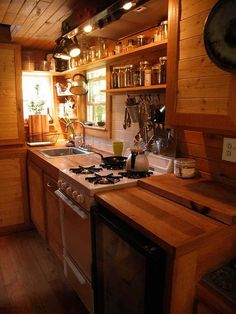 This kitchen is adorable!....like a little, cozy cabin!