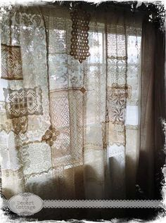 Love these curtains...made with various pieces of lace, zigzag stitched together. Pretty! cm