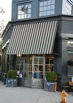 Charcoal Storefront with striped awning and rustic doors- I like the charcoal rather than true black