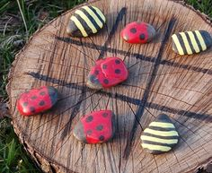 Make a lady bug tic-tac-toe board out of stones and a tree stump!