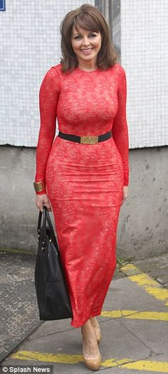 Carol's got back! Vorderman shows off her VERY shapely rear in a clingy red lace dress