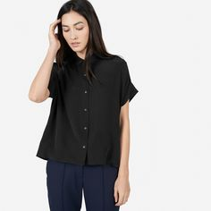 With an oversized fit and a geometric shape, this top has no bad angles 100% silk Features exaggerated hem and subtle darts at the natural waist Dry clean only