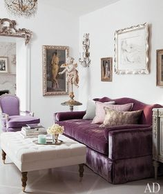 I love the frames, chandelier, the purple velvet sofa and chair.  Love the pop of color.