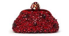 Dolce & Gabbana  Eva embroidered, gem-encrusted clutch with python detailing. €2,750