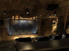 To The Batcave!    While this is only a conceptual rendering, Elite Home Theater Seating owner Bobby Bala describes what it's been like designing the ultimate batcave home theater. Like the bar behind the seats