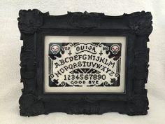 Ouija cross stitch.