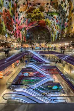 http://www.markthal.nl/ Rotterdam's new market hall, open every day. The ceiling is the largest art work in the world.