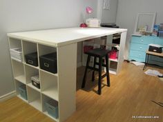 Craft Room Table Easy DIY craft room desk made from an old door and 9 cube shelving unit. Perfect to spread out and create.Easy DIY craft room desk made from an old door and 9 cube shelving unit. Perfect to spread out and create. Craft Room Storage, Craft Tables With Storage, Craft Room Desk, Craft Room Tables, Diy Table, Craft Rooms, Table Storage, Diy Desk, Room Organization
