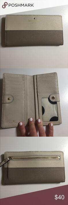Kate Spade wallet Gently used two-tone Kate Spade wallet. Zipper intact. Lighter tan, and darker tan (brown) kate spade Bags Wallets