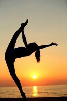 Rhythmic gymnastics at sunset