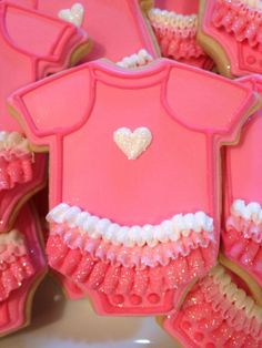 Cut giant cookie into this shape & decorate? girl ruffle onesie cookies. perfect for a baby shower.