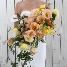 Stunning bright and cherry bouquet with peach and yellow poppies!