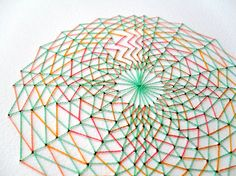 Geometric hand embroidered artwork in green by PixelAndThread
